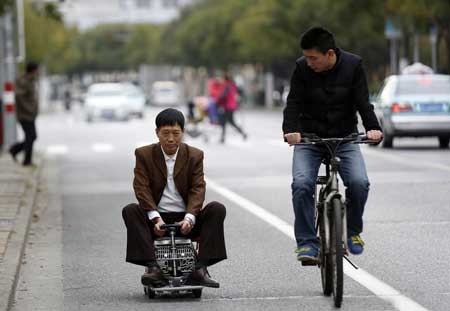 Shanghai Genius Builds Tiny Car to Zoom Through Traffic Jams
