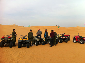 Quad bikes take you on an exhilarating ride across sand dunes
